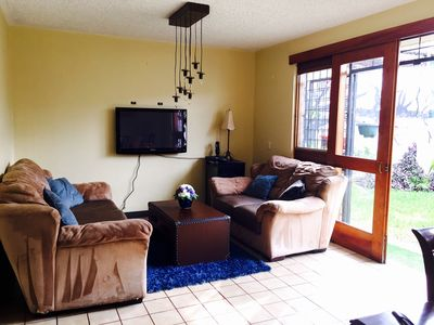 Photo for Large cosy apartment with private covered garden and plenty of light