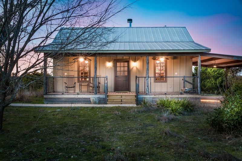 Texas cabin rental with a front porch and rocking chairs in hill country
