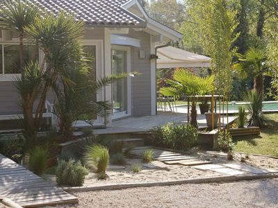 Photo for Wooden villa with pool 4 pers. Wooded and calm situation at 4km SOUSTONS SOUTH