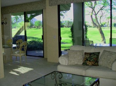 Open living area with plenty of light and sliding doors to the golf course.