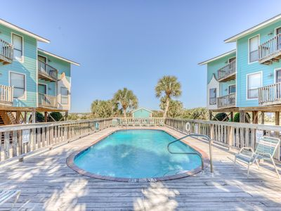 Photo for Two-story condo w/ two balconies, shared pool, & beach access across the street