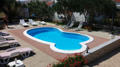 Photo for Holiday apartment with outdoor pool near the beach