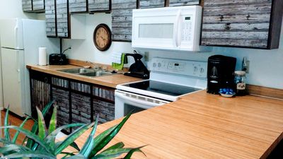 modern kitchen with all full size appliances and snacks