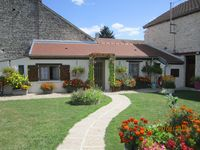 Beautiful peaceful garden near canal in historic Burgundy