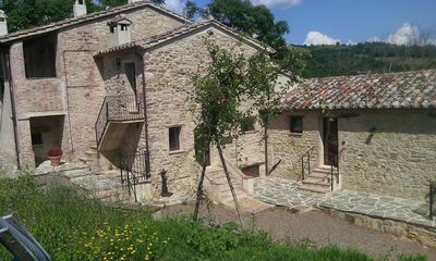 Photo for Country house nestled in the spectacular Umbrian hills (Appartamento Cotoneaster self catering)