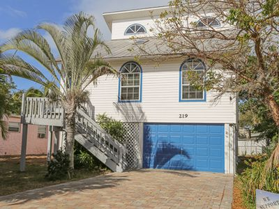 Photo for Enjoy your vacation in this tropical 3 story home conveniently located across the street from the beautiful sandy beach at 219 Fairweather