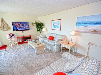 Photo for Comfortable 2 bedroom oceanfront condo full of fun with WiFi, an outdoor pool, and breathtaking sunset views located midtown just a few steps to the beach!