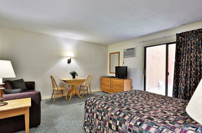 Relax in this spacious studio room with a queen bed and sofa that pulls out into an additional queen size bed.  Cool off with A/C while watching your favorite shows or step out side for some fresh air.