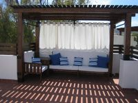 A well located, comfortable and quiet place to stay with a great rooftop terrace.