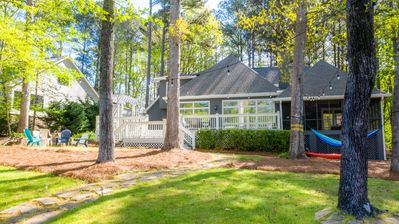 View of firepit, HUGE deck, screened in porch and hammock all yours to enjoy!