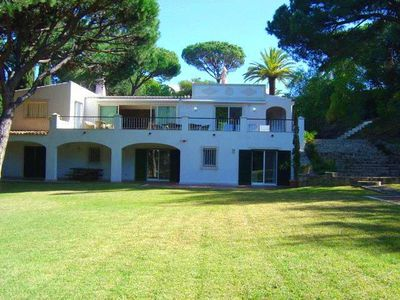 Photo for 5 bedroom Villa, sleeps 14 with Air Con, FREE WiFi and Walk to Beach & Shops