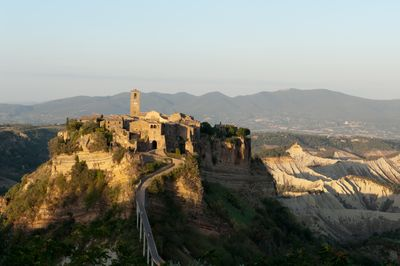 Civita and the stunning Calanchi Valley on the back, behind Umbria