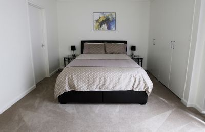 Double bedroom with queen bed and lots of cupboard space