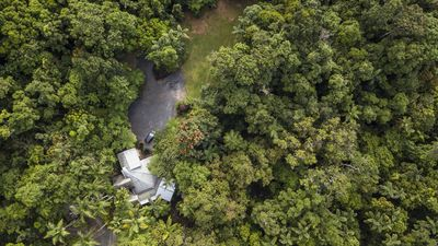 Aerial view of Daintree Secrets in the rainforest and the large flat parking