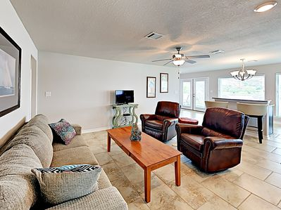 """Living Area - Relax with a movie on the 32"""" TV in the living area furnished with a cushy couch and 2 leather recliners."""