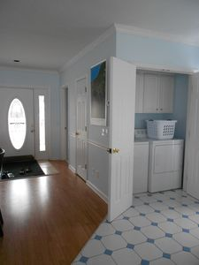 First floor: Entry with view of full-size washer/dryer off the kitchen