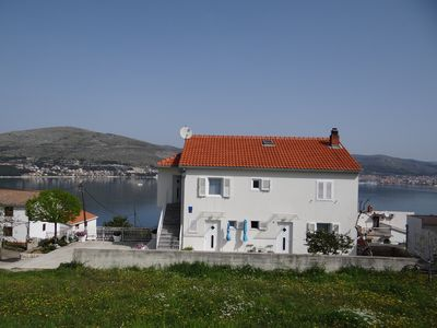Photo for Holiday apartment 50 m from the beach with sea views