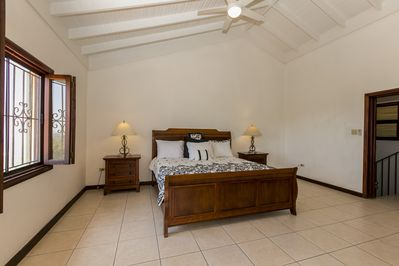 Private master suite with walks closet his and hers bathroom desk, patio and TV.