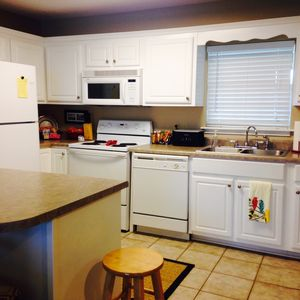 Well equipped kitchen with breakfast bar with seating for five.