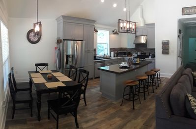 Fully Stocked Kitchen. Common area. Great to gather around and entertain.
