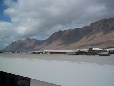 Photo for Bungalow TULIPA in Famara for 4 persons with terrass, garden, views to the ocean, views of the volcanoes, WIFI on the go and less than 20m to the sea