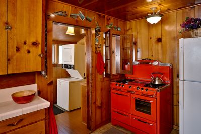 Fully equipped kitchen with vintage red Rachael Ray stove. - Fully equipped kitchen with vintage red Rachael Ray stove.