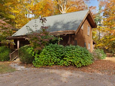 Photo for Woodsy cabin with private hot tub, shared beach access & screened porch