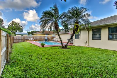Pool area with a privacy fence for your ultimate getaway.