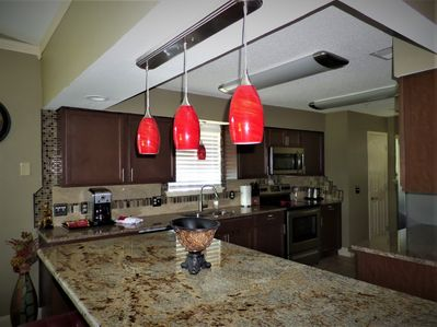 Remodeled Kitchen with Granite, Stainless Appliances, new floors, lights, etc.