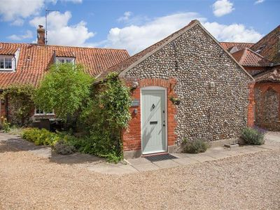 Photo for Courtyard Cottage is a charming single-storey converted barn