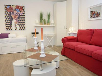 Photo for Bright apartment with a small, functional kitchen and a spacious dining area.