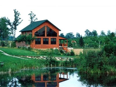 Log Home on Golf Course with pond