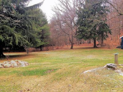 Large rear yard and private forest.