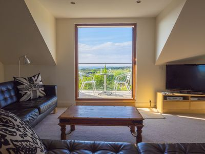 Lounge with double doors leading to balcony with glorious views over the sea