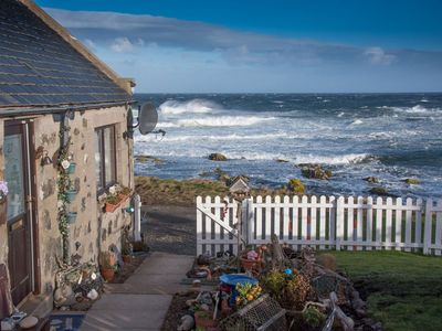 Photo for Pew with a View - Pet Friendly seafront cottage,  secure shorefront garden