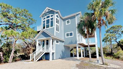 "Photo for Ready Now- No Storm Issues! FREE BEACH GEAR! Plantation, Pets OK, Pool, Screen Porch, Fireplace, 4BR/4.5BA ""Flying High"""