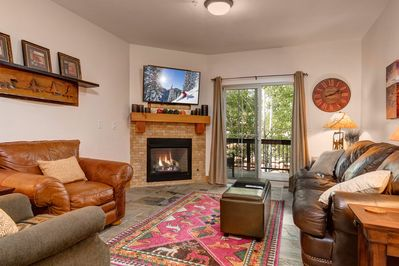 Living Room with TV, Gas Fire Place, Sleeper Sofa and Walk-out Balcony