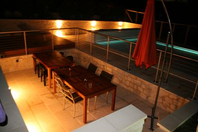 Pool and eating area at night