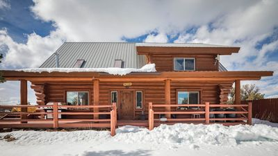 Custom build full log cabin on 80 incredible acres with hot tub, privacy