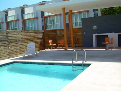 Photo for Spacious & Modern 3-story Condo in Combate Beach , full AC, access to pool