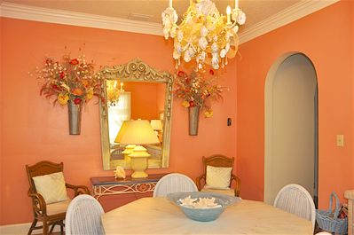 Dining room with old carousel mirror.