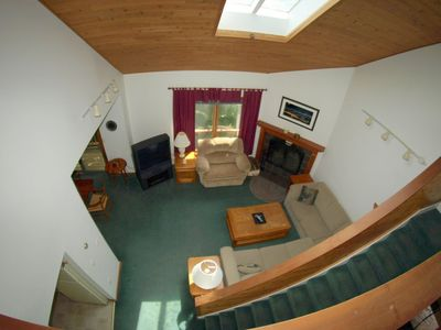 looking down from the large loft into the living room