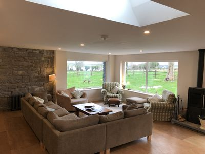 Bayfield's very large sitting room with great views of the gardens & Galway Bay