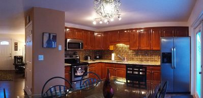 Beautiful remodeled kitchen with granite counters and wood panel floors