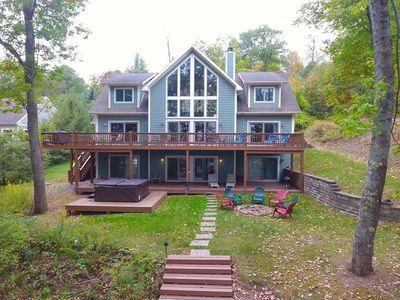 Lakefront home with dock slip, hot tub, fire pit, grills, pool table and fireplaces!
