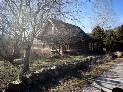 Photo for Charming and secluded log cabin on 120 acre property with wrap around porches.