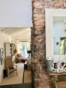 Grand entry with stone fireplace (PRE-REMODEL)