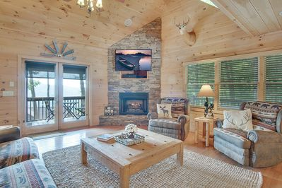 Vaulted family room with a wall of windows and mountain view while on the couch