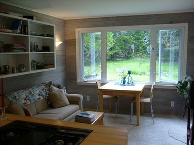 Living area with views of nicely wooded yard