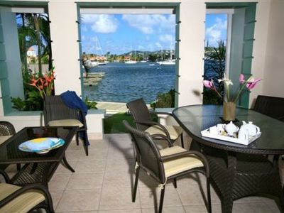 Photo for Luxury waterfront townhouse in gated development close to shops and sandy beach